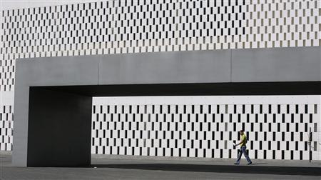 A man walks in a business area in the Andalusian capital of Seville October 4, 2012. REUTERS/Marcelo del Pozo