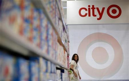 A woman walks through the aisles at a new CityTarget store as they prepare for the store's opening in downtown Chicago July 18, 2012. REUTERS/Jim Young