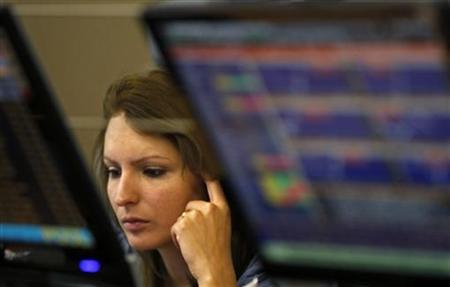 A trader watches screens in a trading room in Lisbon October 3, 2012. REUTERS/Jose Manuel Ribeiro