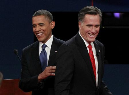 President Barack Obama (L) and Republican presidential nominee Mitt Romney share a laugh at the end of the first presidential debate in Denver October 3, 2012. REUTERS/Jason Reed