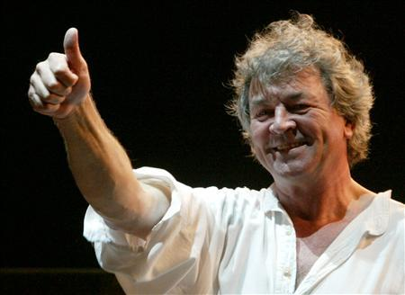 Deep Purple vocalist Ian Gillan gestures to fans during a concert in Shanghai in this April 2, 2004 file photo. REUTERS/Claro Cortes/Files