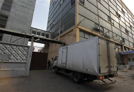 A truck drives into the territory of the ''Sapfir'' scientific and production enterprise, where an office of Sergei Klinov, one of the 11 accused participants in the network, is situated, in Moscow, October 4, 2012. REUTERS/Maxim Shemetov