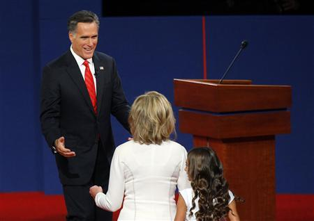Republican presidential nominee and former Massachusetts Governor Mitt Romney (back) greets his wife Ann at the conclusion of the first U.S. 2012 presidential debate with U.S. President Barack Obama in Denver October 3, 2012. REUTERS/Brian Snyder