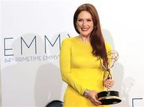 "Actress Julianne Moore holds the Emmy award for outstanding lead actress in a miniseries or movie for ""Game Change"" at the 64th Primetime Emmy Awards in Los Angeles September 23, 2012. REUTERS/Mario Anzuoni"
