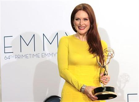 Actress Julianne Moore holds the Emmy award for outstanding lead actress in a miniseries or movie for ''Game Change'' at the 64th Primetime Emmy Awards in Los Angeles September 23, 2012. REUTERS/Mario Anzuoni