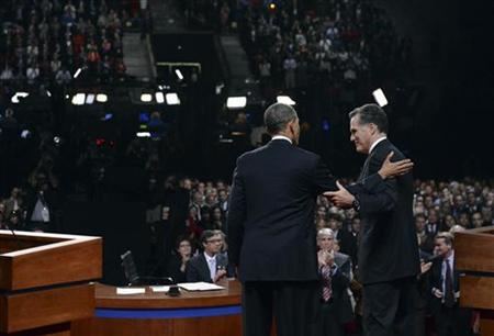 Republican presidential nominee Mitt Romney greets President Barack Obama at the end of the first 2012 U.S. presidential debate in Denver October 3, 2012. REUTERS/Michael Reynolds/Pool