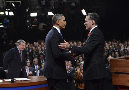 Republican presidential nominee Mitt Romney shakes hands with President Barack Obama as mediator Jim Lahrer gets up at the end of the first 2012 U.S. presidential debate in Denver October 3, 2012. REUTERS/Michael Reynolds/Pool