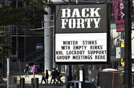 A pub near the home arena of the NHL Vancouver Canucks posts a sign in regarding the current league and players dispute in Vancouver, British Columbia October 1, 2012. REUTERS/Andy Clark