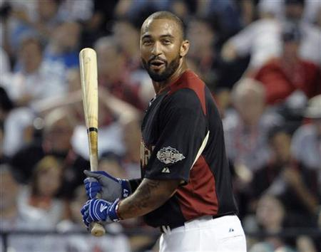 The National League's Matt Kemp, of the Los Angeles Dodgers, reacts in the first round of Major League Baseball's Home Run Derby at the All-Star Game in Phoenix, Arizona July 11, 2011. REUTERS/Denis Poroy