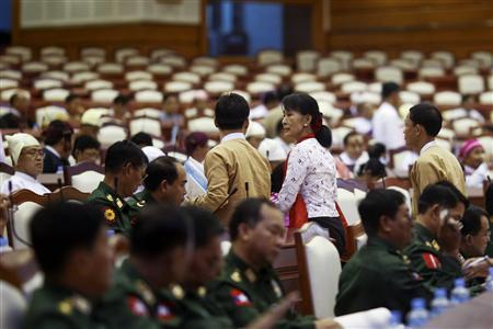 Myanmar's pro-democracy leader Aung San Suu Kyi arrives for a session of the Lower house of country's Parliament in Naypyitaw August 7, 2012. REUTERS-Soe Zeya Tun