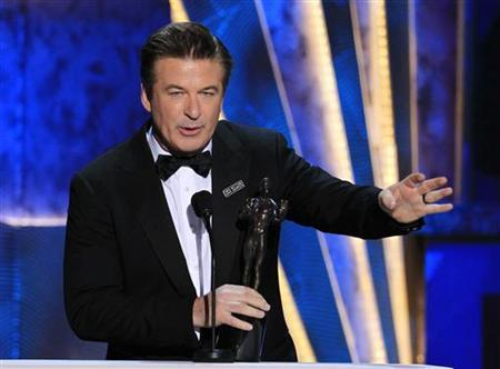 Actor Alec Baldwin accepts the award for outstanding performance by a male actor in a comedy series for ''30 Rock'' at the 18th annual Screen Actors Guild Awards in Los Angeles, California January 29, 2012. REUTERS/Lucy Nicholson