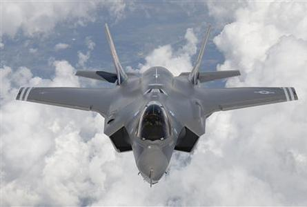 An F-35 Lightning II, also known as the Joint Strike Fighter (JSF), is seen as it arrives at Edwards Air Force Base in California in this May 2010 file photograph. REUTERS/Tom Reynolds/Lockheed Martin Corp/Handout/Files