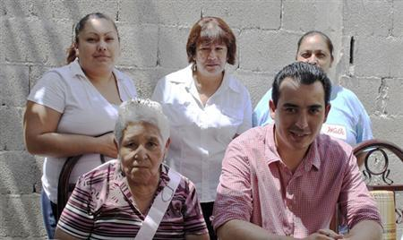 Jose Eduardo Moreira (R front row), the son of the former chairman of Mexico's Institutional Revolutionary Party (PRI) and ex-Coahuila state governor Humberto Moreira, poses for a photograph with others in Acuna August 28, 2012. REUTERS/State Government of Coahuila/Handout
