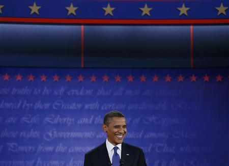President Barack Obama smiles during the first presidential debate with Republican presidential nominee Mitt Romney (not pictured) in Denver October 3, 2012. REUTERS/Jim Bourg