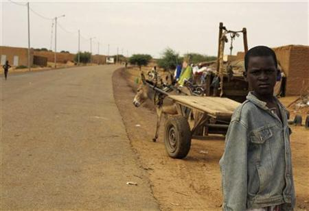 A boy stands on a street in Boni village September 4, 2012. REUTERS/Adama Diarra