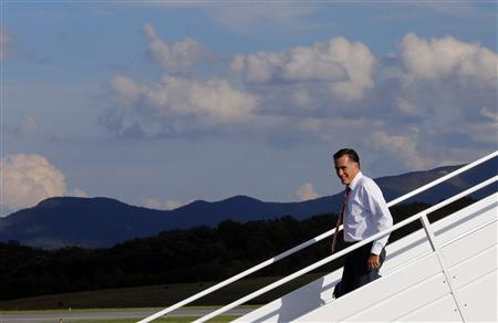 Republican presidential nominee Mitt Romney gets off his campaign plane at the airport in Weyers Cave, Virginia October 4, 2012. REUTERS/Brian Snyder