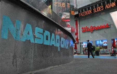 The Nasdaq logo is seen on the exterior of the Nasdaq MarketSite as a headline about the Facebook stock scrolls on the Times Square Newsticker, in New York, May 22, 2012. REUTERS/Brendan McDermid