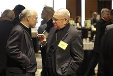 Bishop Salvatore Cordileone and Bishop Walter Edyvean chat after an executive session of United States Conference of Catholic Bishops Spring General Assembly in Bellevue, Washington, June 16, 2011. REUTERS/Marcus Donner