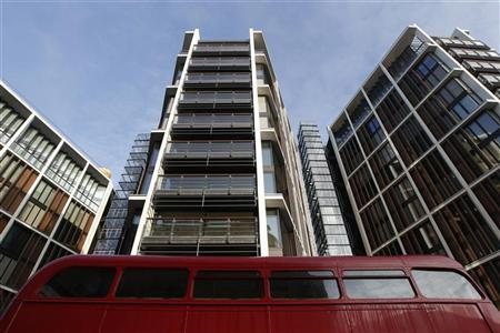 A Routemaster bus passes new development One Hyde Park, in London January 19, 2011. REUTERS/Luke MacGregor