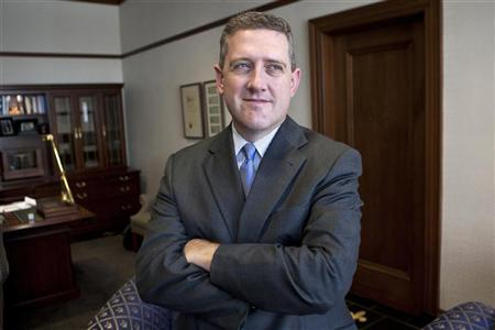 President of the Federal Reserve Bank of St. Louis James Bullard poses during an interview at the Federal Reserve Bank of St. Louis June 8, 2011. REUTERS/Peter Newcomb