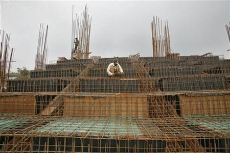 Labourers work at the construction site of a stadium on the outskirts of Agartala, September 28, 2012. REUTERS/Jayanta Dey
