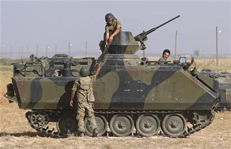 Turkish soldiers stand guard on the Turkish-Syrian border near the Akcakale border crossing, southern Sanliurfa province, October 4, 2012. REUTERS/Murad Sezer