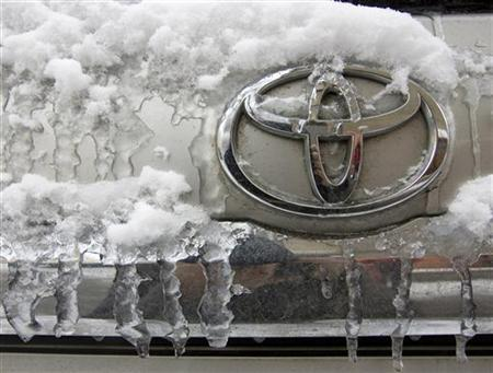 The Toyota logo is seen on a car covered with snow and ice at a parking lot in Almaty February 5, 2010. REUTERS/Shamil Zhumatov