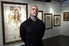 "Artist Vincent Castiglia poses for a portrait prior to the opening of his gallery show ""Resurrection"", at Sacred Gallery in New York October 3, 2012. REUTERS/Andrew Burton"