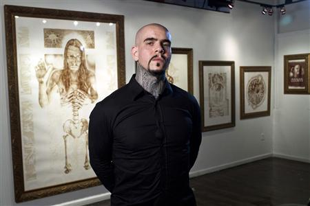 Artist Vincent Castiglia poses for a portrait prior to the opening of his gallery show ''Resurrection'', at Sacred Gallery in New York October 3, 2012. REUTERS/Andrew Burton
