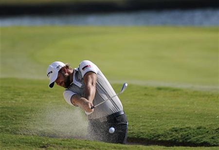 Ryan Moore of the U.S. hits from the fairway bunker on the 17th hole during the third round of the Tour Championship golf tournament at the East Lake Golf Club in Atlanta, Georgia September 22, 2012. REUTERS/David Tulis