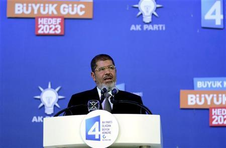 Egypt's President Mohamed Mursi makes a speech during Turkey's Prime Minister Tayyip Erdogan's ruling Justice and Development Party (AKP) congress in Ankara September 30, 2012. REUTERS/Kayhan Ozer/Prime Minister's Press Office/Handout
