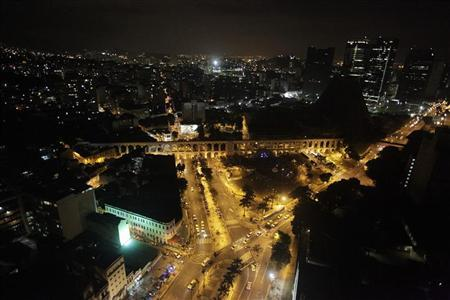 Rio de Janeiro's Arcos da Lapa square is pictured after lights were turned off for Earth Hour March 26, 2011. REUTERS/Ricardo Moraes