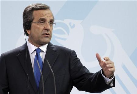 Greek Prime Minister Antonis Samaras addresses a news conference after talks with German Chancellor Angela Merkel in Berlin, August 24, 2012. REUTERS/Tobias Schwarz