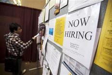 A man looks at a job board posted at a job fair in Toronto, April 1, 2009. REUTERS/Mark Blinch