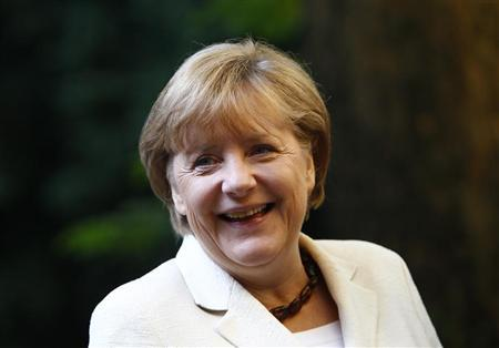 German Chancellor Angela Merkel arrives for an oecumenic service at the St. Michaels church during the 22nd German Unification Day festivities in Munich October 3, 2012. REUTERS/Michaela Rehle