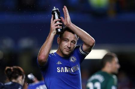 Chelsea captain John Terry salutes the fans after their English League Cup soccer match against Wolverhampton Wanderers at Stamford Bridge in London September 25, 2012. REUTERS/Eddie Keogh
