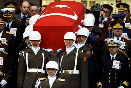 Presidential honour guard carry coffin of President Turgut Ozal as Turkish generals with drawn swords accompany them during a funeral procession in Ankara in this April 21, 1993 file photo. REUTERS/Fatih Saribas