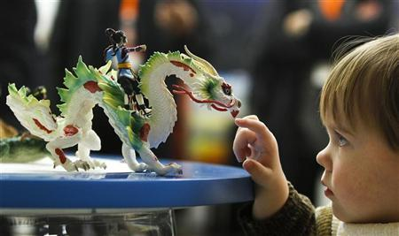 A boy is playing with a new fantasy toy figure by Schleich during the press preview of the 62th International Toy Fair in Nuremberg February 2, 2011. REUTERS/Michaela Rehle