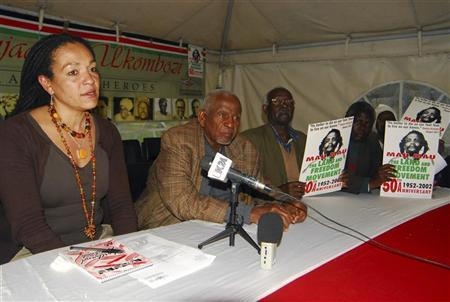 (L to R) The Kenya Human Rights commission official Muthoni Wanyeki, the Mau Mau war veterans association spokesman, Gitu wa Kahengeri, the association's Deputy Secretary Augustine Kamunde and assistant secretary general Francis Mutiso take part in a news conference in Kenya's capital Nairobi July 21, 2011. Four Kenyans were given the go-ahead at the High Court on Thursday to sue the British government in a test case over alleged atrocities committed by the British army during the anti-colonial Mau Mau uprising. REUTERS/Stringer