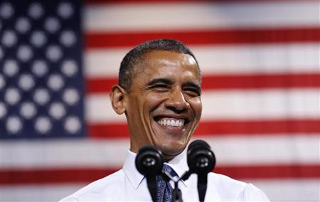 U.S. President Barack Obama smiles as he speaks during a campaign rally in Fairfax, Virginia October 5, 2012. REUTERS/Kevin Lamarque