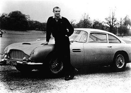 1964 FILE PHOTO - Sean Connery poses with the Aston Martin from ''Goldfinger'' in this 1964 photo. BOND