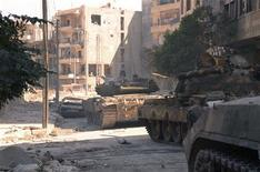 Syrian army tanks are seen in the Suleiman al-Halabi neighborhood after clashes between Free Syrian Army fighters and regime forces, in Aleppo city October 5, 2012. REUTERS/George Ourfalian