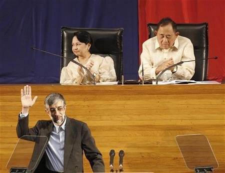 Philippine President Gloria Macapagal Arroyo (upper L) and Jose De Venecia, a speaker of the House of the Representatives, gesture while Gholam Ali Haddad Adel, a Iran speaker, waves after his speech during the special plenary session centennial celebration of the House of Representatives in Manila June 7, 2007. REUTERS/Romeo Ranoco