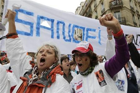 Employees of French drugmaker Sanofi attend a demonstration in Paris to protest planned layoffs October 3, 2012. REUTERS/Philippe Wojazer
