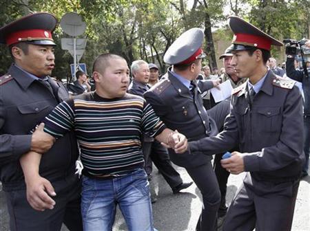 Police detain a protester during an opposition rally in Kyrgyzstan's capital Bishkek October 3, 2012. REUTERS/Vladimir Pirogov