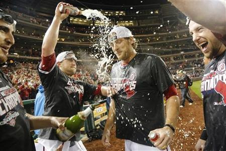 Washington Nationals pitcher Ross Detwiler (center) celebrates with teammates on the field after clinching their National League East Division championship at the end of their MLB National League baseball game against the Philadelphia Phillies in Washington, October 1, 2012. REUTERS/Jonathan Ernst