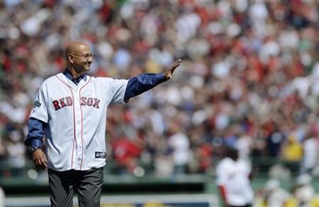 Former Boston Red Sox manager Terry Francona gestures to the crowd as he takes the field during the pre-game ceremony as Fenway Park commemorates its 100th year anniversary before the start of American League MLB baseball game between the Boston Red Sox and New York Yankees at Fenway Park in Boston, Massachusetts April 20, 2012. REUTERS/Gretchen Ertl