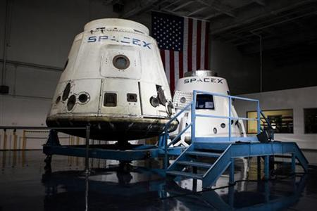 SpaceX spacecrafts the Dragon (L) and the DragonRider sit on display before NASA Administrator Charles Bolden and SpaceX CEO and Chief Designer Elon Musk address SpaceX employees following the first successful mission by a private company to carry supplies to the International Space Station at the SpaceX facility in Hawthorne, California June 14, 2012. REUTERS/Bret Hartman