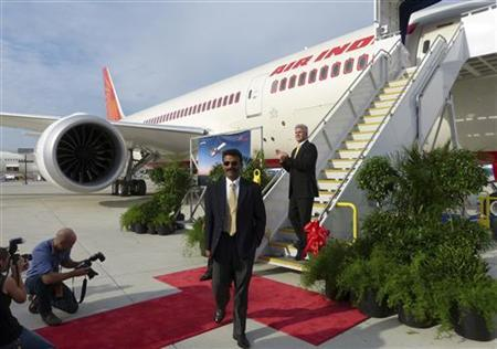 Air India pilot Amitabh Singh (C), and Boeing South Carolina vice president and general manager Jack Jones take part in a ribbon-cutting ceremony to mark Air India's receipt of the first 787 manufactured at the South Carolina final assembly plant in North Charleston, South Carolina October 5, 2012. REUTERS/Harriet McLeod