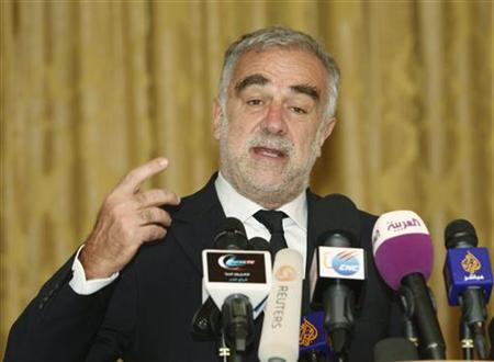 Luis Moreno-Ocampo gestures during a news conference in Tripoli April 21, 2012. REUTERS/Ismail Zitouny/Files
